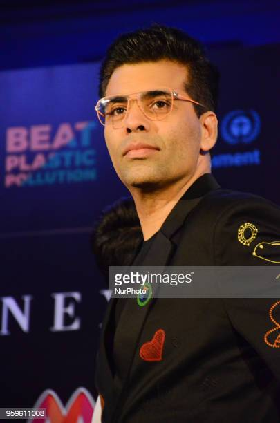Bollywood movie director Karan Johar poses for photographers after a press conference by Wizcraft to announce the 19th Edition of IIFA Weekend amp...