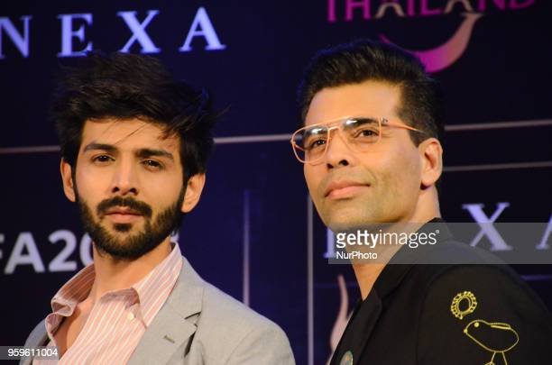 Bollywood movie star Kartik Aaryan and director Karan Johar pose for photographers after a press conference by Wizcraft to announce the 19th Edition...