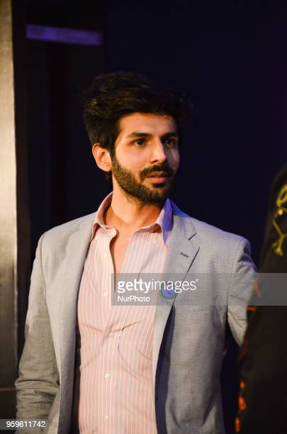 Bollywood movie star Kartik Aaryan poses for photographers after a press conference by Wizcraft to announce the 19th Edition of IIFA Weekend amp...