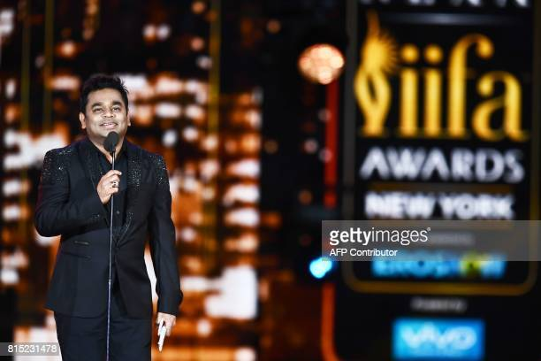 Bollywood music composer/singer AR Rahman accepts an award during the 18th International Indian Film Academy Festival at the MetLife Stadium in East...