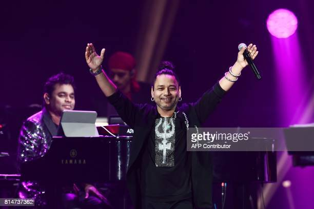 Bollywood music composer/singer AR Rahman plays piano as singer Kailash Kher performs on stage during IIFA Rocks part of the 18th International...