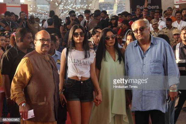 Bollywood producer Boney Kapoor with his wife Sridevi and politician Amar Singh at red carpet during Justin Bieber's concert at DY Patil Stadium...