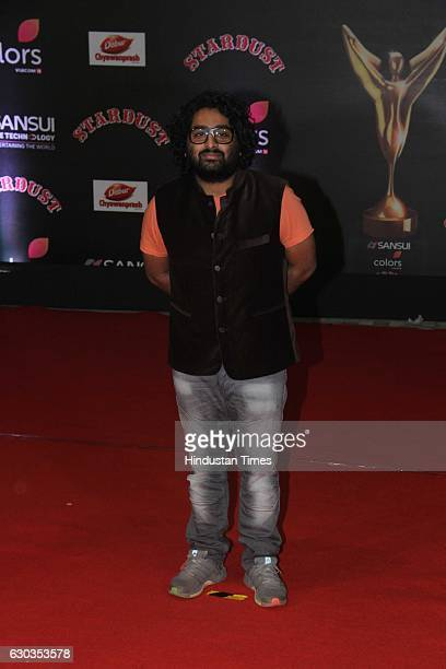 Bollywood singer Arijit Singh poses on red carpet for shutterbugs during the Sansui Colors Stardust Awards 2016 on December 19 2016 in Mumbai India