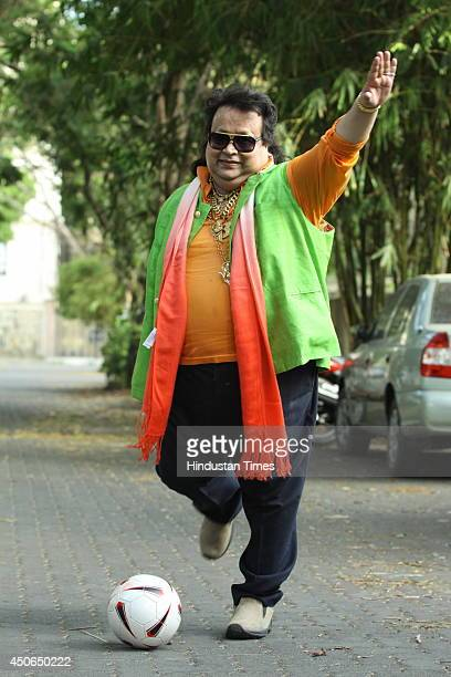 Bollywood singer Bappi Lahiri poses during the launch of his song Life for Football on June 12 2014 in Mumbai India The song is specially sung during...