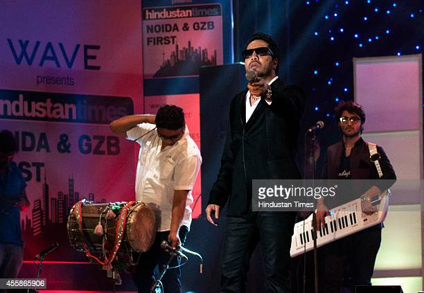 Bollywood singer Mika Singh performs during a concert as a part of Hindustan Timess Noida and Ghaziabad first initiative on September 20 2014 in...