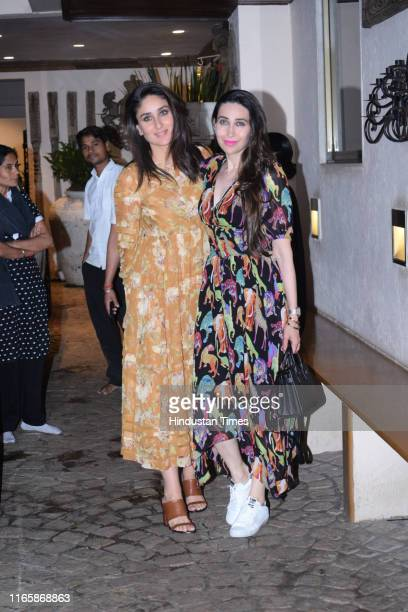 Bollywood sisters Kareena Kapoor Khan and Karishma Kapoor seen posing for the shutterbugs in Juhu on August 28 2019 in Mumbai India