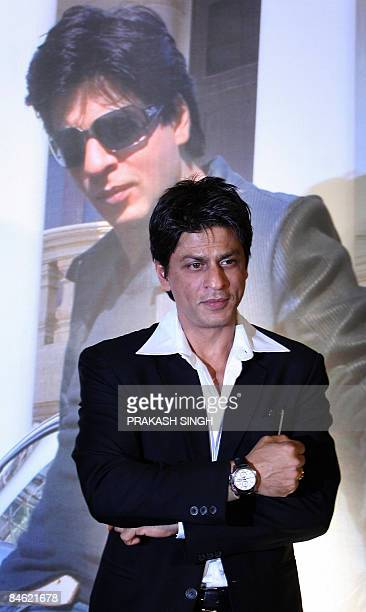 Bollywood star and Tag Heuer Brand Ambassador Shahrukh Khan displays his Tag Heuer watch during the inauguaration of the Tag Heuer concept boutique...