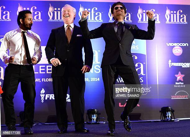 Bollywood star Anil Kapoor and an unidentified background dancer engage the mayor of Tampa Bob Buckhorn into a dance to the tune of the IIFA anthem...