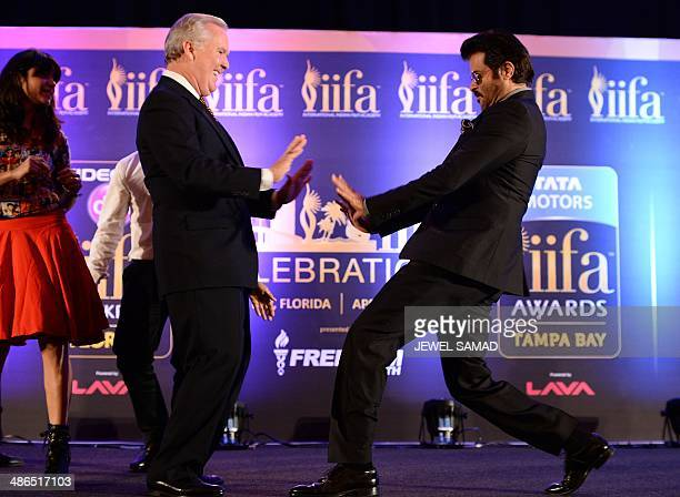 Bollywood star Anil Kapoor engages the mayor of Tampa Bob Buckhorn into a dance to the tune of the IIFA anthem Do Da Tampa on stage during a press...