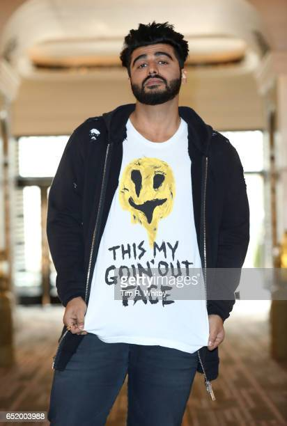 Bollywood Star Arjun Kapoor attends a photocall for the Bollywood comedy 'Mubarakan' on March 11 2017 at the Sheraton Park Lane Hotel in London...