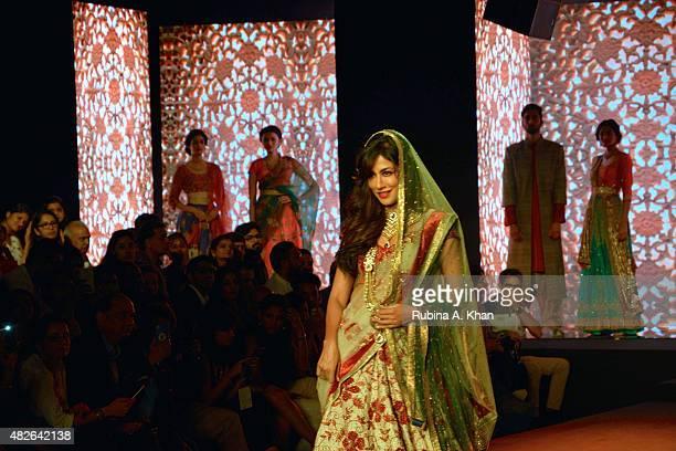 Bollywood star Chitrangada Singh models Kolkatabased designer Debarun who showcased his debut couture collection a modern interpretation of Bollywood...