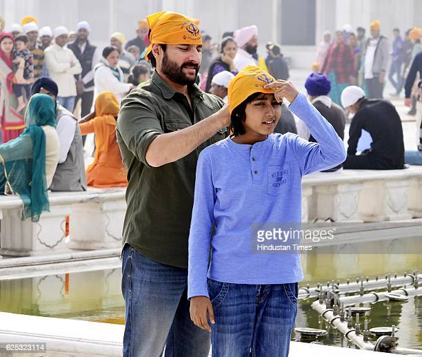 Bollywood star Saif Ali Khan along with other during the shooting on the set of the forthcoming Hindi film 'Chef' at Entrance Plaza of Golden Temple...