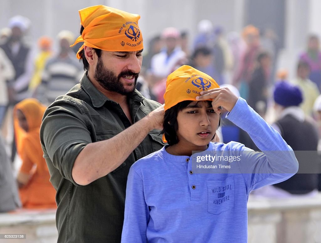 Bollywood star Saif Ali Khan along with other during the shooting on the set of the forthcoming Hindi film `Chef` at Entrance Plaza of Golden Temple..