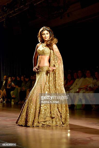 Bollywood star Shilpa Shetty models in a molten gold ensemble for Rimple and Harpreet Narula's couture line inspired by the erstwhile days of the...