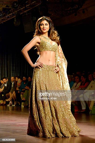 Bollywood star Shilpa Shetty owned the runway as she walked in a molten gold ensemble for Rimple and Harpreet Narula's couture line inspired by the...