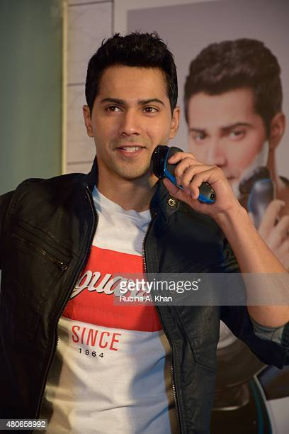 Bollywood star Varun Dhawan the first brand ambassador for Philips India's shaving line the Philips AquaTouch Wet and Dry Electric Shaver at a press...