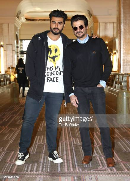 Bollywood Stars Arjun Kapoor and Anil Kapoor attend a photocall for the Bollywood comedy 'Mubarakan' on March 11 2017 at the Sheraton Park Lane Hotel...