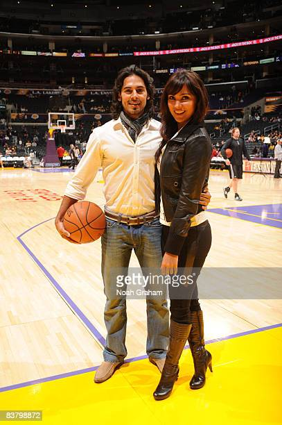 Bollywood stars Dino Morea and Lara Dutta pose for a photograph prior to the game between the Sacramento Kings and the Los Angeles Lakers at Staples...