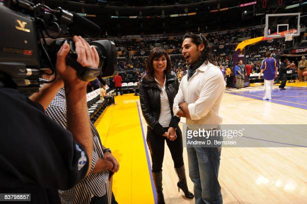 Bollywood stars Lara Dutta and Dino Morea field questions from the media before the game between the Sacramento Kings and the Los Angeles Lakers at...