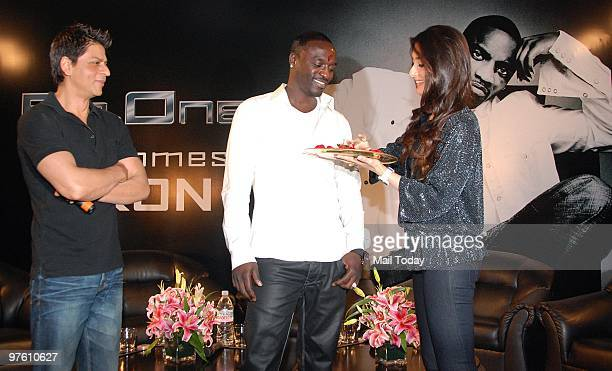 Bollywood stars Shah Rukh Khan Kareena Kapoor and singer Akon at a news conference for their forthcoming movie 'RaOne' in Mumbai March 9 2010