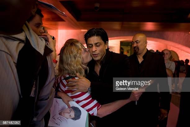 Bollywood superstar Shah Rukh Khan allows himself to be kissed by a fan as he arrives at Somerset House in London for the world premiere of his new...