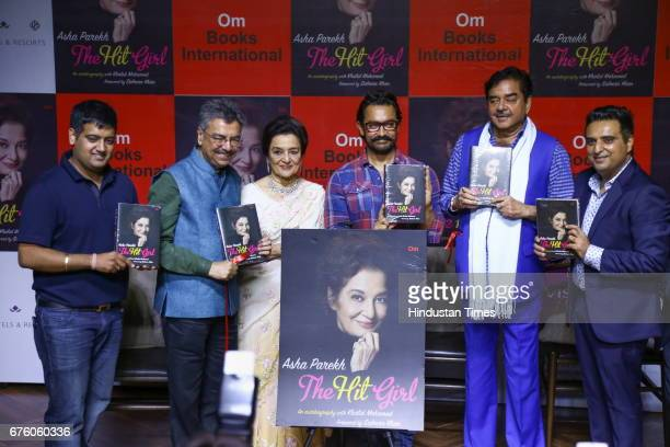 Bollywood veteran actor Asha Parekh with actor Aamir Khan and actorturnedpolitician Shatrughan Sinha during the launch of her autobiography The Hit...