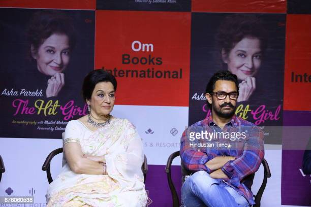 Bollywood veteran actor Asha Parekh with actor Aamir Khan during the launch of her autobiography The Hit Girl cowritten with film critic Khalid...