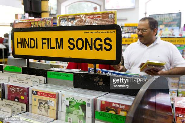Bollywood video compact disks are displayed for sale at Rhythm House in Mumbai India on Saturday April 16 2011 India's film industry generated an...