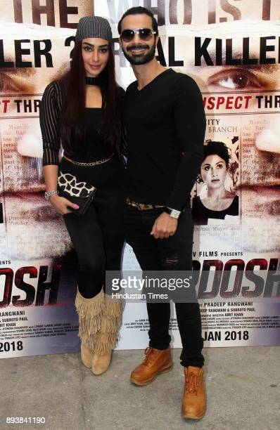Bollywoood actors Maheck Chahal and Ashmit Patel during the trailer launch of film 'Nirdosh' at Sunny Super Sound Juhu on December 12 2017 in Mumbai...