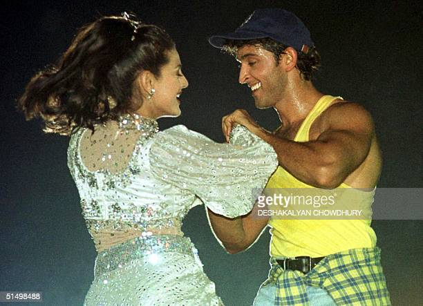 Bollywoood Megastar Hrithik Roshan dances with actress Amisha Patel during a show in Calcutta 11 November 2000 Over 1000 people thronged to watch...