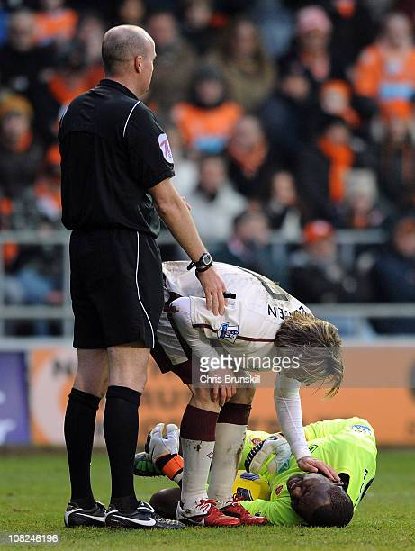 Bolo Zenden of Sunderland checks on the condition of Richard Kingson of Blackpool during the Barclays Premier League match between Blackpool and...