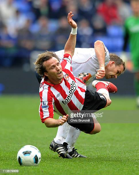 Bolo Zenden of Sunderland is fouled by Kevin Davies of Bolton Wanderers during the Barclays Premier League match between Bolton Wanderers and...
