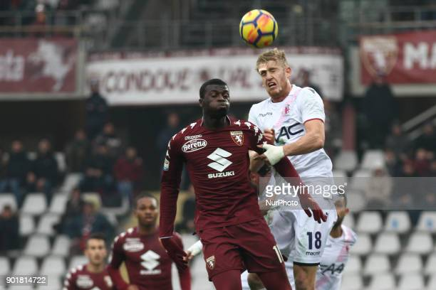 Bologna defender Filip Helander and Torino forward M'Baye Niang heads the ball during the Serie A football match n20 TORINO BOLOGNA on at the Stadio...