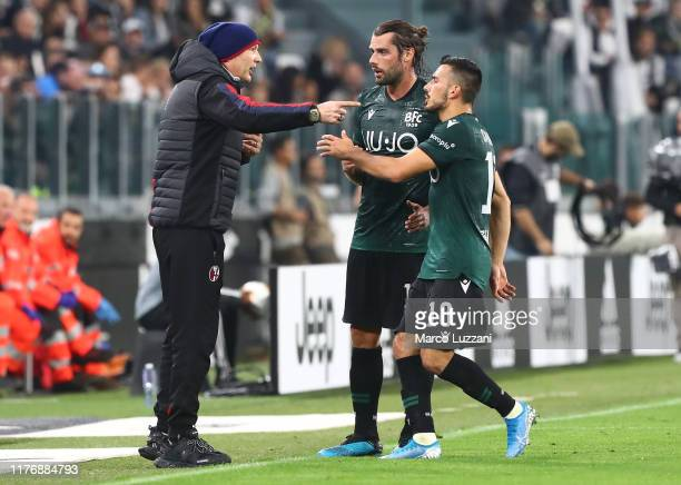 Bologna FC coach Sinisa Mihajlovic instructions to his players Andrea Poli and Nicola Sansone during the Serie A match between Juventus and Bologna...