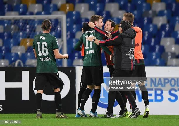 Bologna FC players celebrate the 11 goal scored by Andreas Skov Olsen during the Serie A match between SSC Napoli and Bologna FC at Stadio San Paolo...