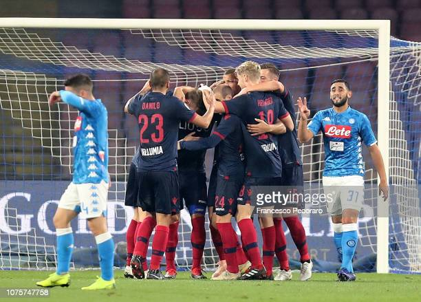 Bologna FC players celebrate the 11 goal scored by Federico Santander beside the disappointment of Dries Mertens and Faouzi Ghoulam of SSC Napoli...