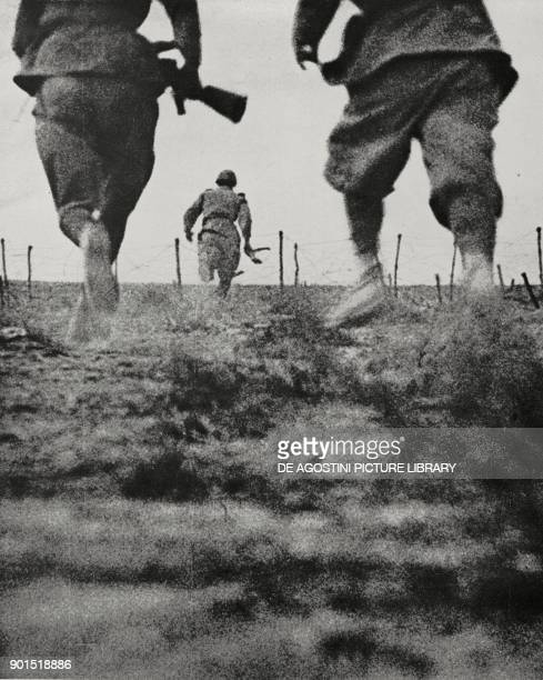 Bologna infantry division running towards the attack Battle of Marmarica Libya World War II from L'Illustrazione Italiana Year LXVIII No 49 December...