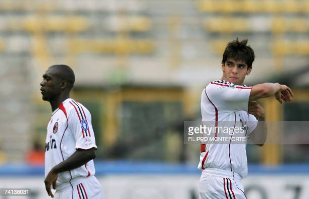Milan's midfielders Ricardo Kaka and Clarence Seedorf gesture during theirItalian serie A football match against Catania at Bologna's Renato Dall'Ara...