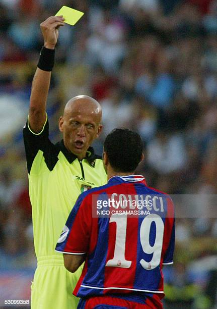 Italian referee Pierluigi Collina gives the yellow card to Bologna's player Marco Colucci during the football match Bologna vs Parma in the second...