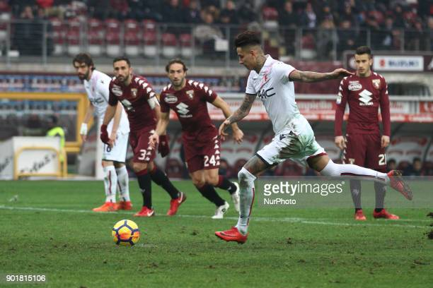 Bologna midfielder Erick Pulgar shoots the ball by penalty kick during the Serie A football match n.20 TORINO - BOLOGNA on at the Stadio Olimpico...