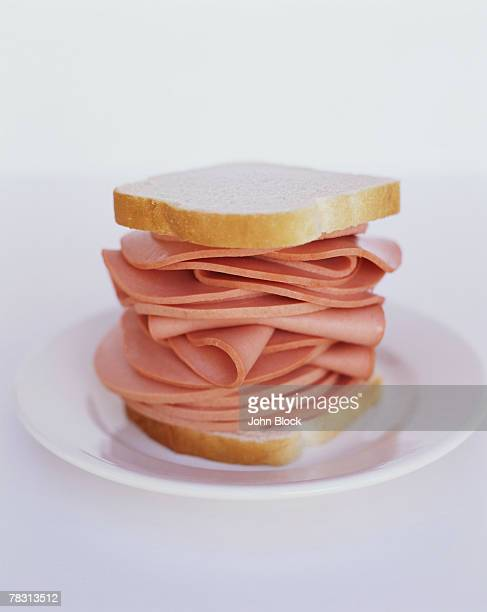 bologna on white bread - bologna stock pictures, royalty-free photos & images