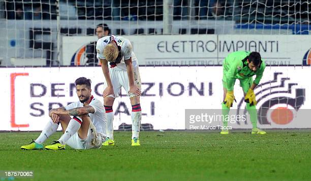 Bologna players look disappointed after conceding the second goal during the Serie A match between Atalanta BC and Bologna FC at Stadio Atleti...
