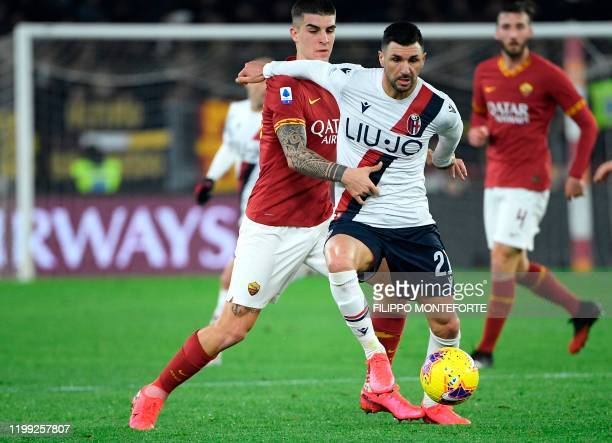 Bologna's Brazilian defender Danilo is tackled by AS Roma's French midfielder Jordan Veretout during the Italian Serie A football match between AS...