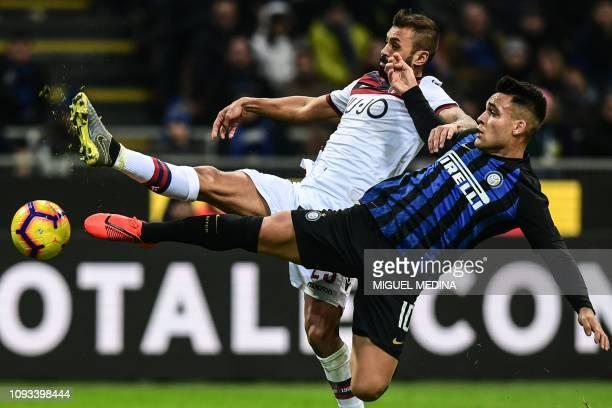 Bologna's Brazilian Italian defender Danilo Larangeira and Inter Milan's Argentine forward Lautaro Martinez go for the ball during the Italian Serie...