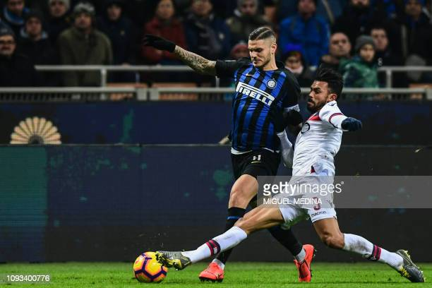 Bologna's Costa Rican defender Giancarlo Gonzalez tackles Inter Milan's Argentine forward Mauro Icardi during the Italian Serie A football match...