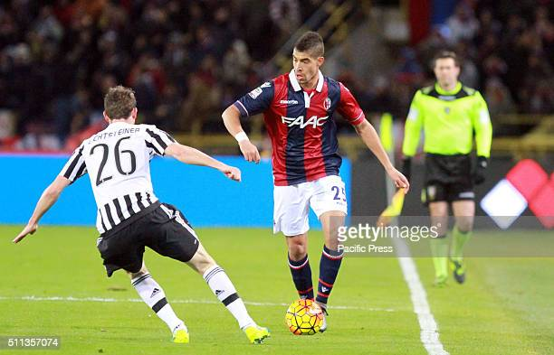 Bologna's defender Adam Masina run with thw ball in front of him Juventus's defender Stephan Lichtsteiner during the Italian Serie A football match...