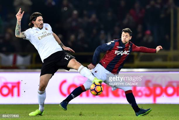Bologna's forward from Italy Mattia Destro vies for the ball with AC Milan's defender from Italy Alessio Romagnoli during the Italian Serie A...