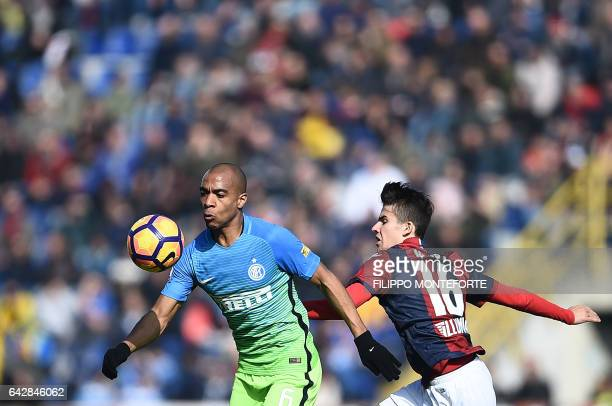 Bologna's Hungarian midfielder from Adam Nagy vies with Inter Milan's Portuguese midfielder Joao Mario during the italian Serie A football match...