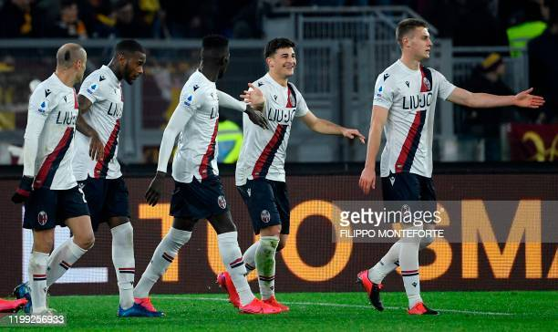 Bologna's Italian forward Riccardo Orsolini celebrates scoring his team's first goal during the Italian Serie A football match between AS Roma and...