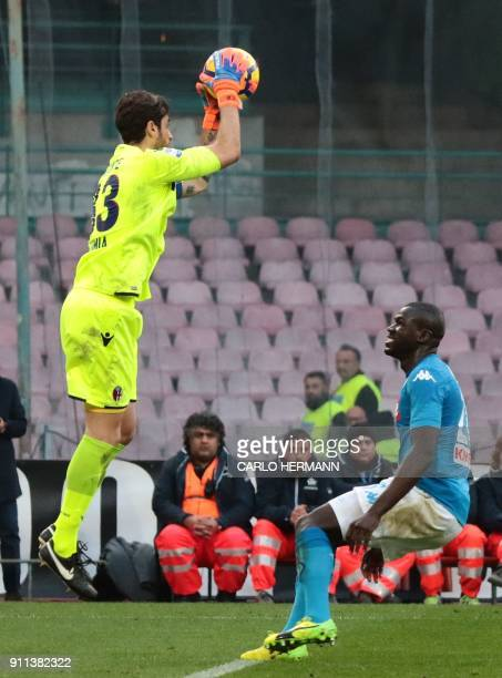 Bologna's Italian goalkeeper Antonio Mirante saves the ball in front of Napoli's French defender Kalidou Koulibaly during the Italian Serie A...